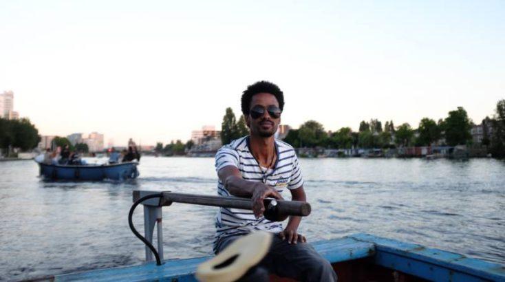 Positive Travel Guide - Amsterdam Sami van Rederij Lampedusa refugee canal cruise