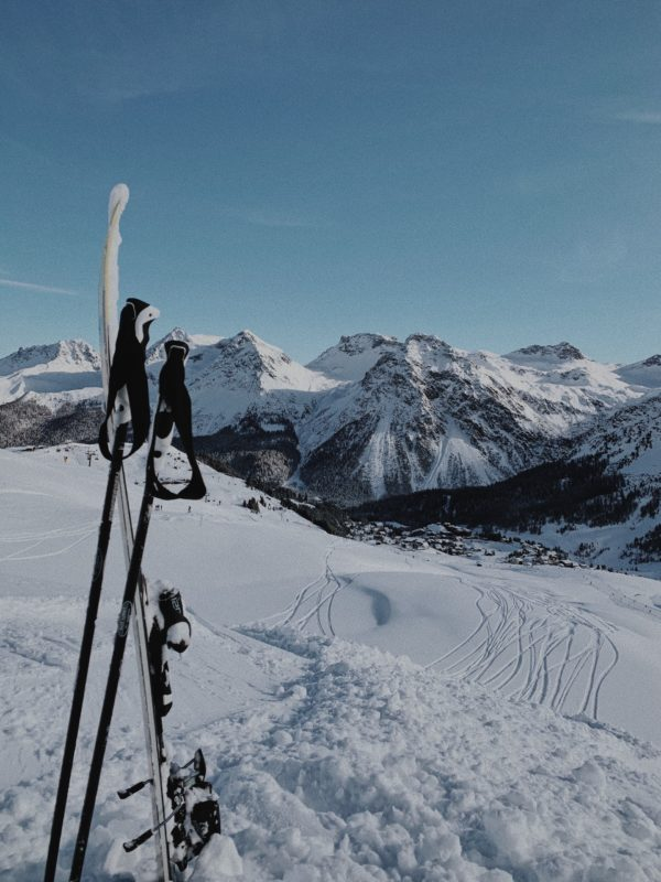 Positive Travel Best Sustainable Ski Resorts in Switzerland Arosa snowy slope with skis view