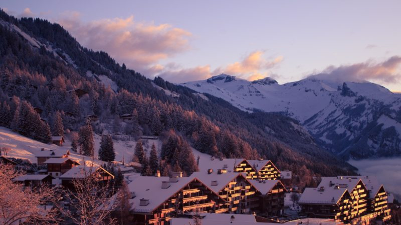 Positive Travel Best Sustainable Ski Resorts in Switzerland Anzère village and mountain winter view at sunset