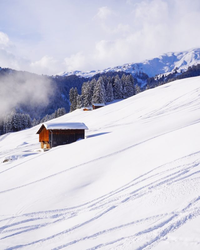 Positive Travel Best Sustainable Ski Resorts in Switzerland Laax mountain slop covered with snow