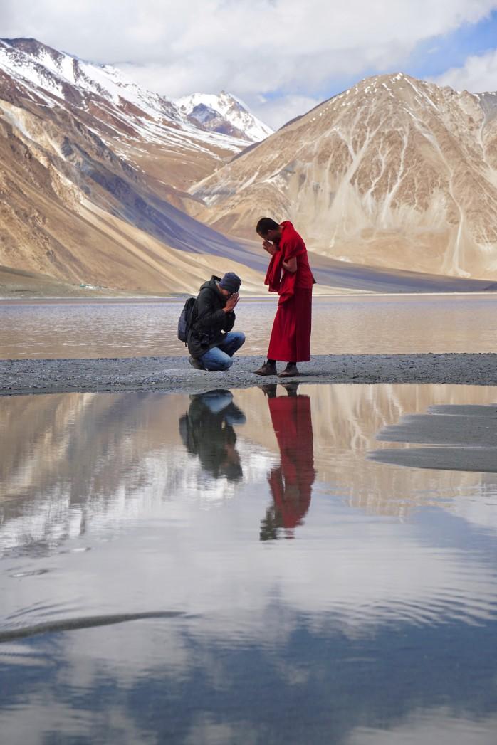 buddhist-man-pay-respect-to-monk-at-pangong-lake-ladakh-jammu-and-kashmir-india
