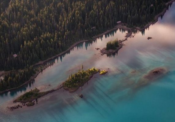 Aerial view of beautiful Glacier Lake in Canadian Mountain Landscape during a vibrant sunset. Taken in Garibaldi, near Squamish and Whistler, North of Vancouver, BC, Canada.
